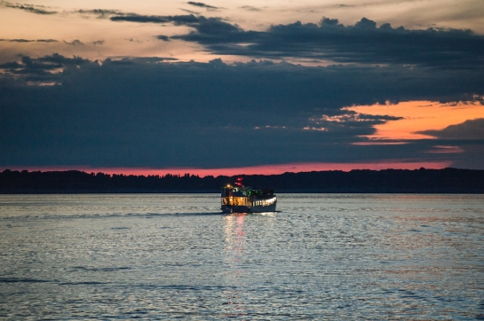 Outlook - boat by sunset - credit Marc Sethi